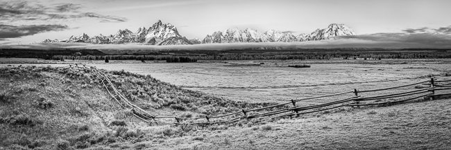 Dawn breaks on the Grand Tetons across the grasses of Triangle X Ranch.