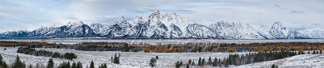 Jagged snowcapped peaks of the Grand Tetons rise above Jackson Valley